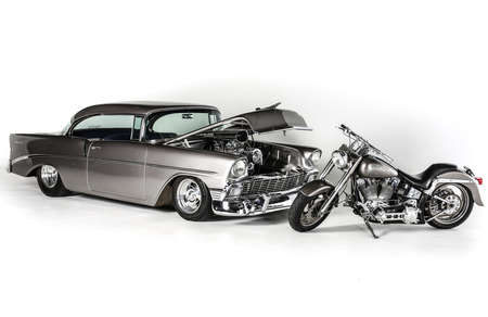 chevrolet: Chevrolet Coup 1956 and Retro Harley Davidson Isolated on White Background with matching paint jobs