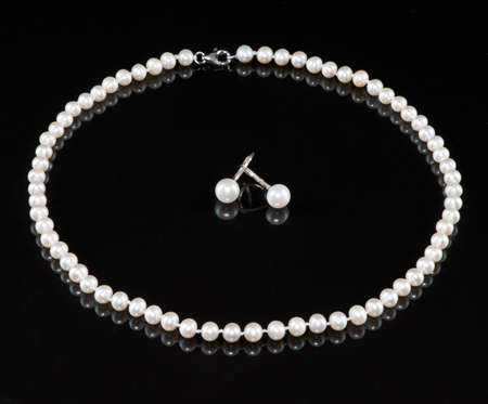 A string of pearls and earrings photo