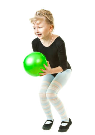 A girl playing with a green ball photo
