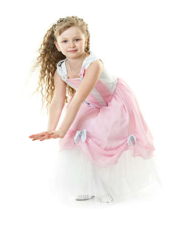 Little girl in a beautiful rose dress isolated photo