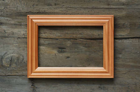 wooden photo frame on old wooden wall photo