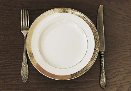 antique fork, knife and plate photo
