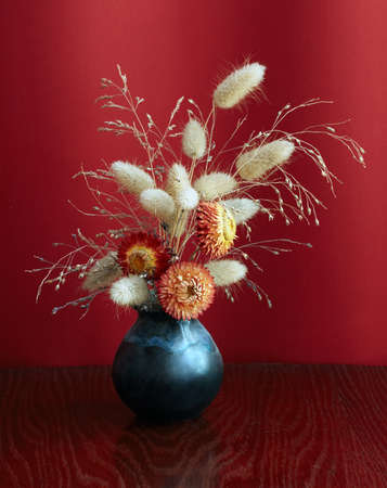 ikebana on red background photo