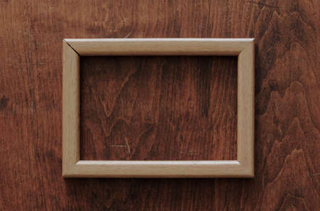 blank frame on old wooden backgroundtural; old; ornamental; photo; photograph; picture; plank; retro; room; rough; rustic; rusty; stain; surface; texture; textured; vintage; wall; wallpaper; wood; wooden photo