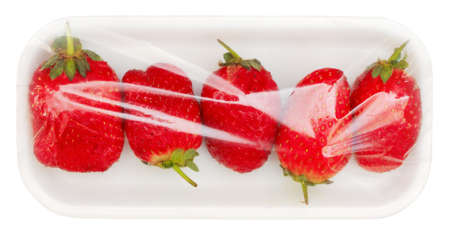 packed: strawberry in vacuum packing isolated on white background with clipping path