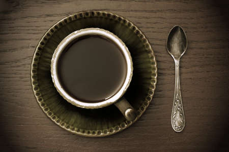 vintage coffee cup on wooden table photo