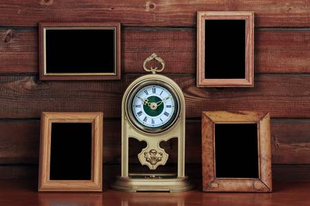 old photo frames and antique clock on wooden table Stock Photo - 10783166