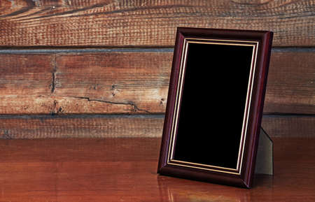 black picture frame: photo frame on old table