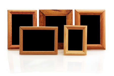 vintage wooden photo frames on white background with reflection  photo