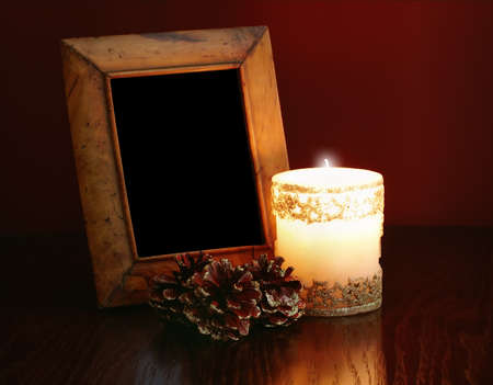 christmas card, vibtage photo-frame on a table at candlelight photo