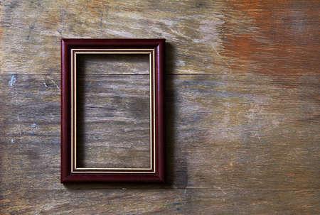 empty photo-frame on wooden background Stock Photo - 10783343
