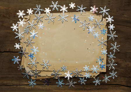 paper on wooden wall, christmas background  photo
