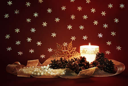 vintage christmas decoration with candle, pinecones and ribbon photo