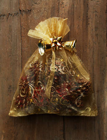 Christmas bag with gifts on wooden wall photo