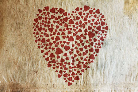 background with vintage heart on old paper texture  photo