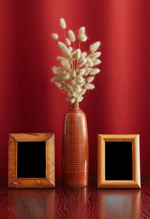 vintage photo-frames and ikebana on table photo