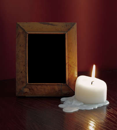 wibtage photoframe on a table at candlelight photo