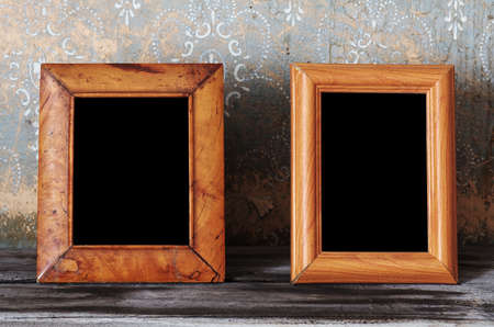 two vintage photo-frames on old table photo