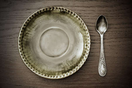 old dessert plate and spoon photo