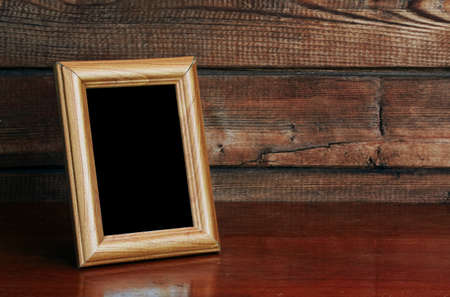 photo frame on old table Stock Photo - 11374598