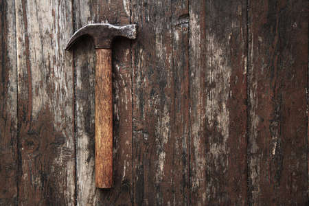 tool against wooden wall photo