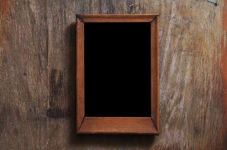 empty photo-frame on wooden background photo