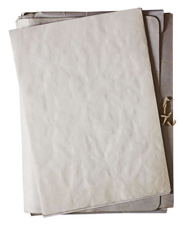 old folder with stack of old papers isolated on white background with clipping path photo