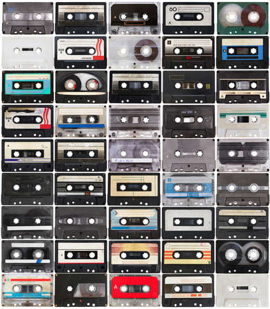 collection of retro audio tapes isolated on white background photo