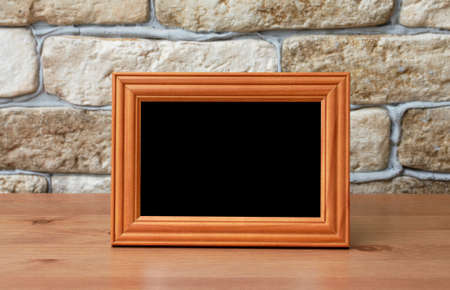 old photo frame on the wooden table Stock Photo