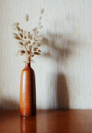 antique vase: ikebana on table