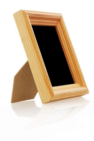 vintage wooden photo frame on white background with reflection  photo