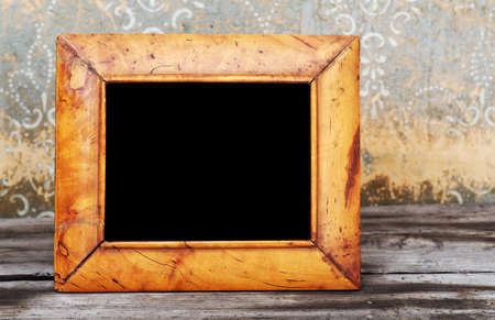 vintage photo-frame on old table photo