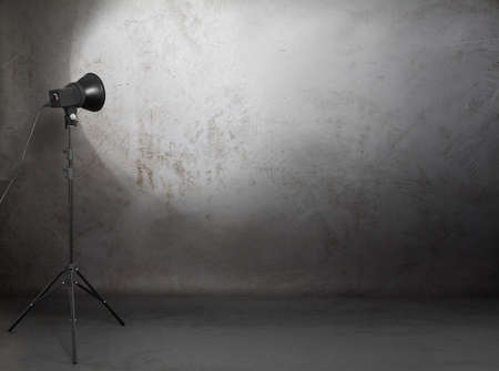 photo backdrop: photo studio in old grunge room with concrete wall, urban background  Stock Photo