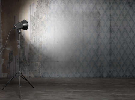 photo studio in old grunge interior with retro wallpaper