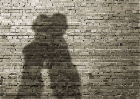 shadow of the man and the woman on dirty brick wall  photo