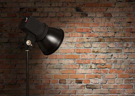 spot light on brick wall photo