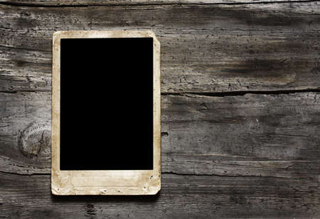 Antique photo frame on wooden background photo