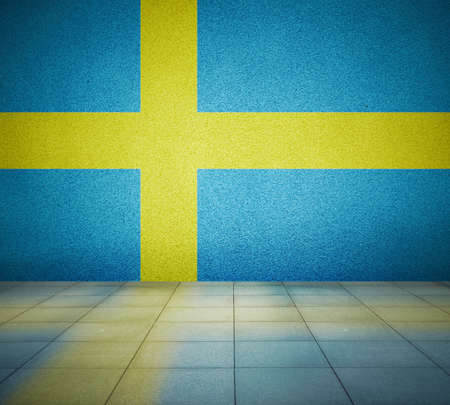 Sweden flag on the wall in empty room, studio background photo