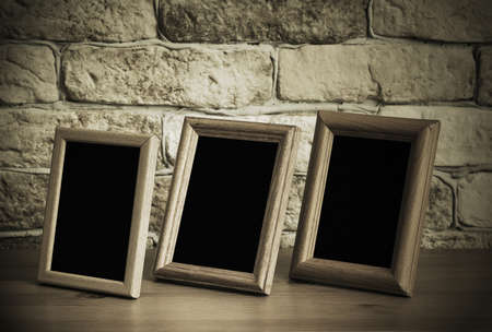 old photo frames on the wooden table photo