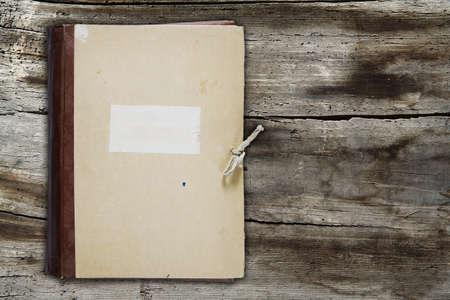 old folder on old wooden background photo