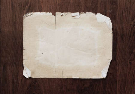 vintage paper on old wood texture Stock Photo - 15406659