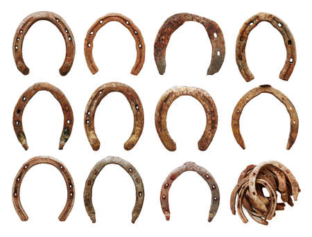 set of old horseshoes on white background  版權商用圖片