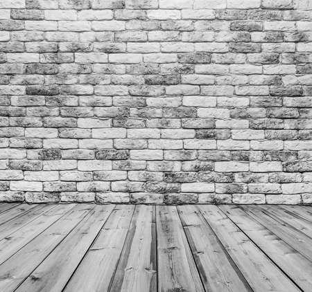 old room with brick wall, black and white background photo
