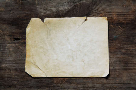 vintage paper on old wooden texture Stock Photo - 16161911