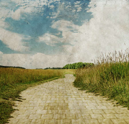 stone road: yellow brick road through green meadows, old fantasy grungy illustration