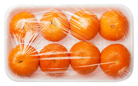 tangerines in vacuum packing isolated on white background photo