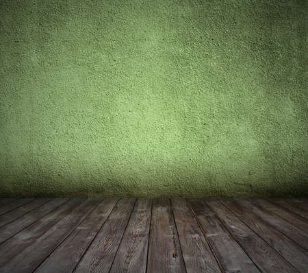 old room with concrete wall and wooden floor, green background photo