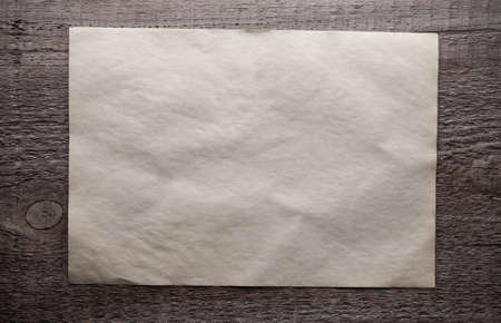old paper on dirty wooden background Stock Photo - 17484751