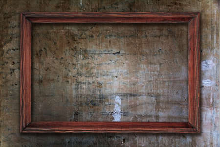 blank photo frame on old wall Stock Photo - 17484653