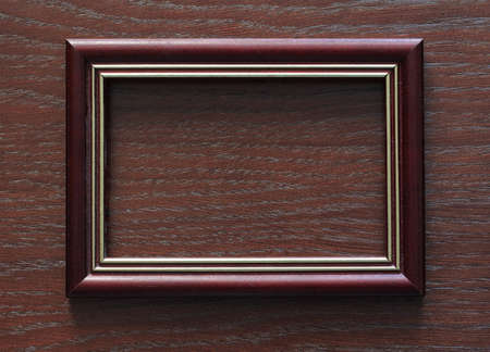blank frame on old wooden backgroundtural; old; ornamental; photo; photograph; picture; plank; retro; room; rough; rustic; rusty; stain; surface; texture; textured; vintage; wall; wallpaper; wood; wooden Stock Photo - 17559099